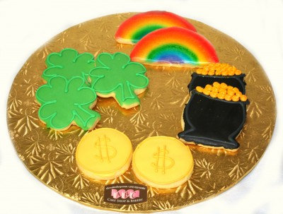 St patricks cookies in the shape of Shamrocks, pot-of-gold, rainbow, and coins
