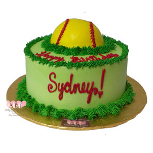 Baseball in the grass round cake sideview